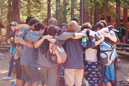 Group of boys hugging at camp