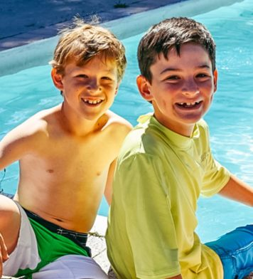 Two boys at summer camp by the pool