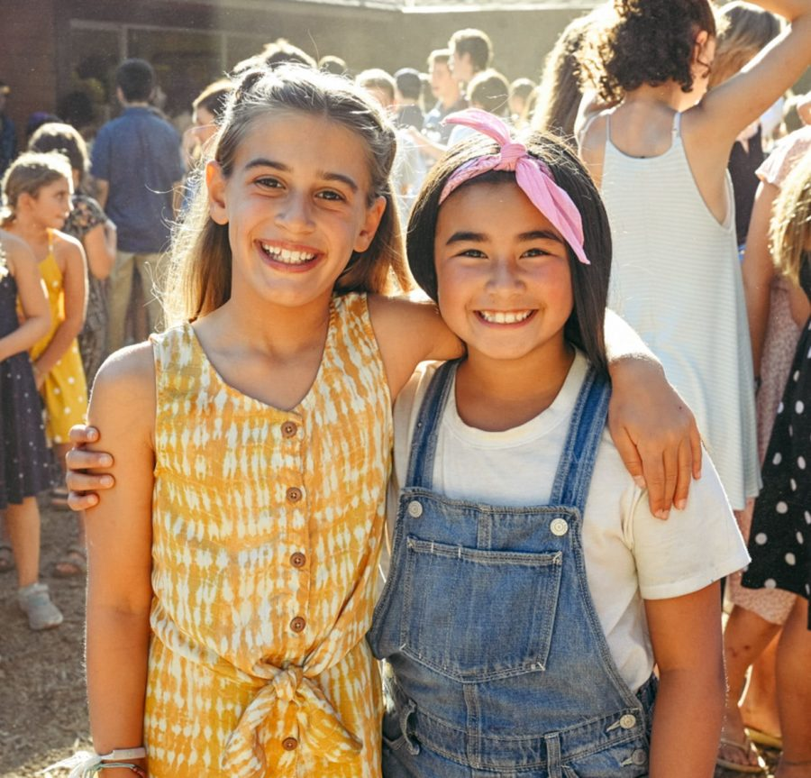 Two girls smiling at camp