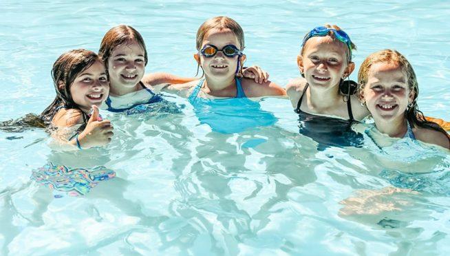 Girls swimming in pool