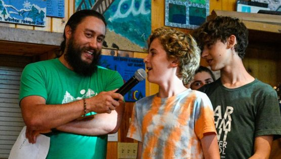Staff with microphone letting camper speak