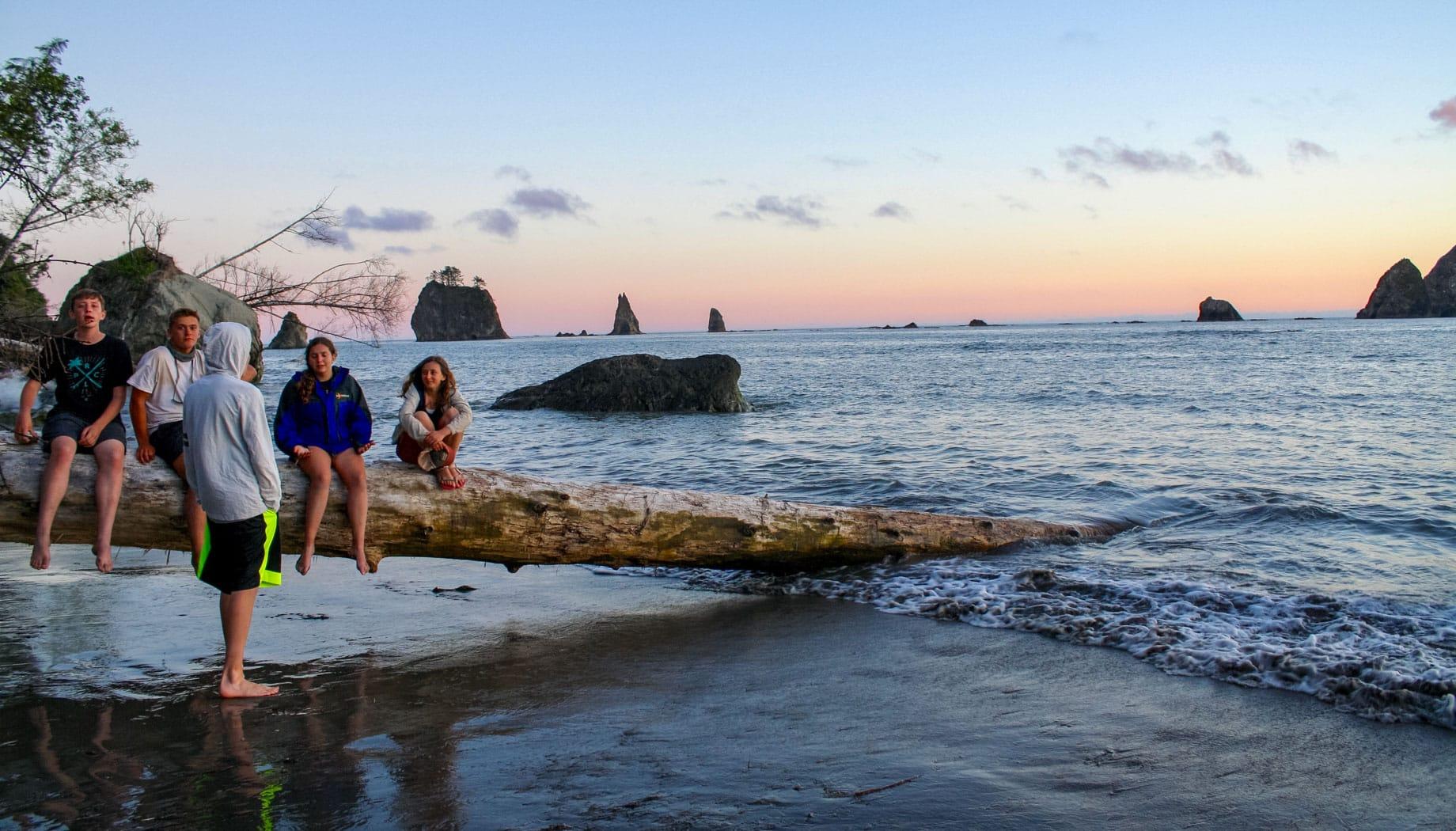 Admiring beach sunset on the Northwest Canada quest