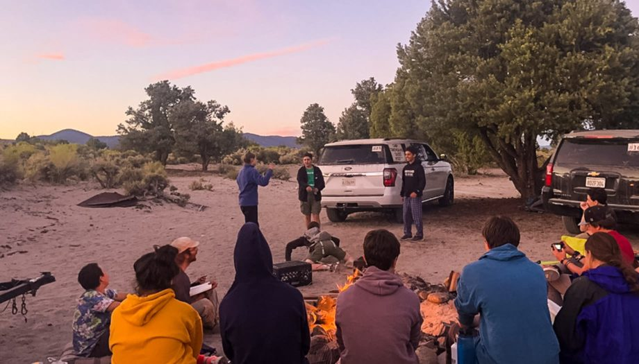 Campfire at sunset on the Rock and River quest