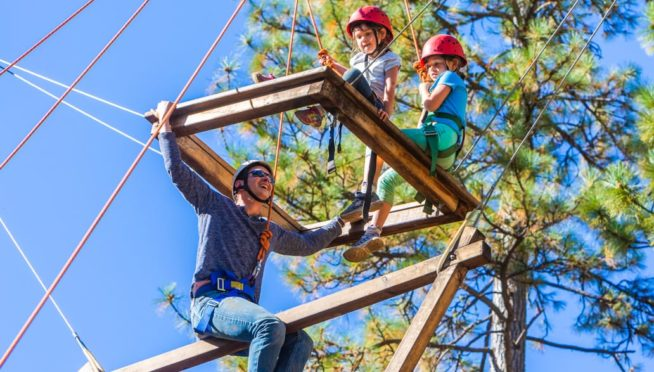 Family on ropes course during family camp