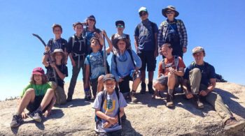 Hikers on rocks on the Sierra Slam quest