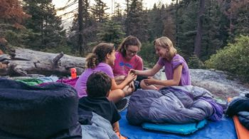 Campers on Taste of Quest in sleeping bags