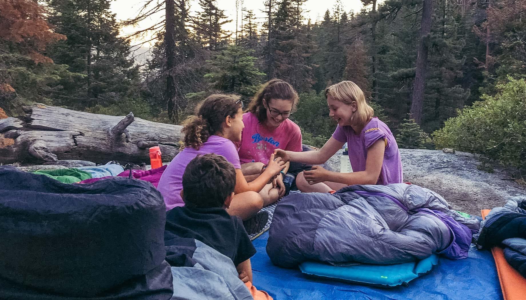 Campers on Taste of Quest in sleeping bags