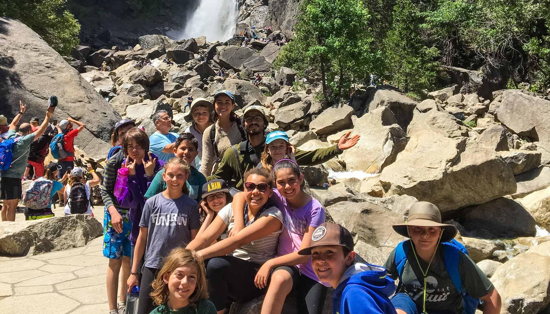 Hikers by waterfall on Taste of Quest
