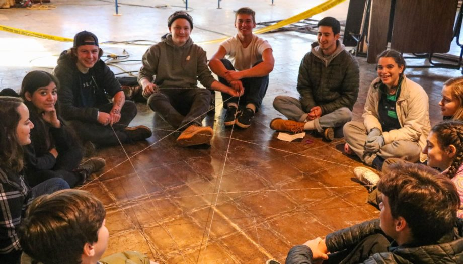 Group of kids on teen winter retreat playing games