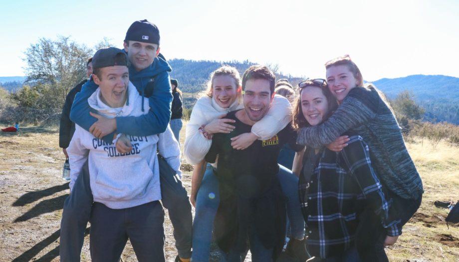 Group of kids on teen winter retreat singing