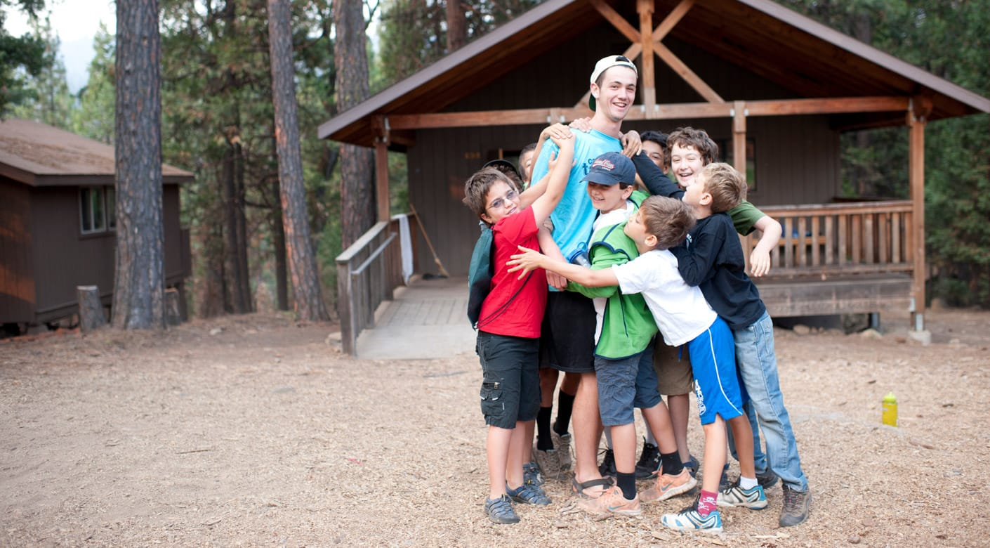 Boys hugging a camp counselor