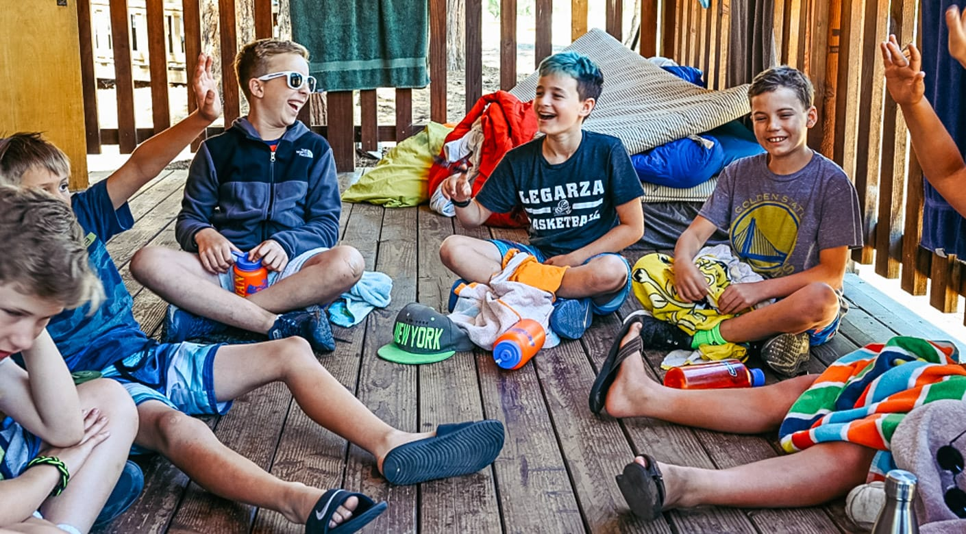 Boys playing games on cabin porch