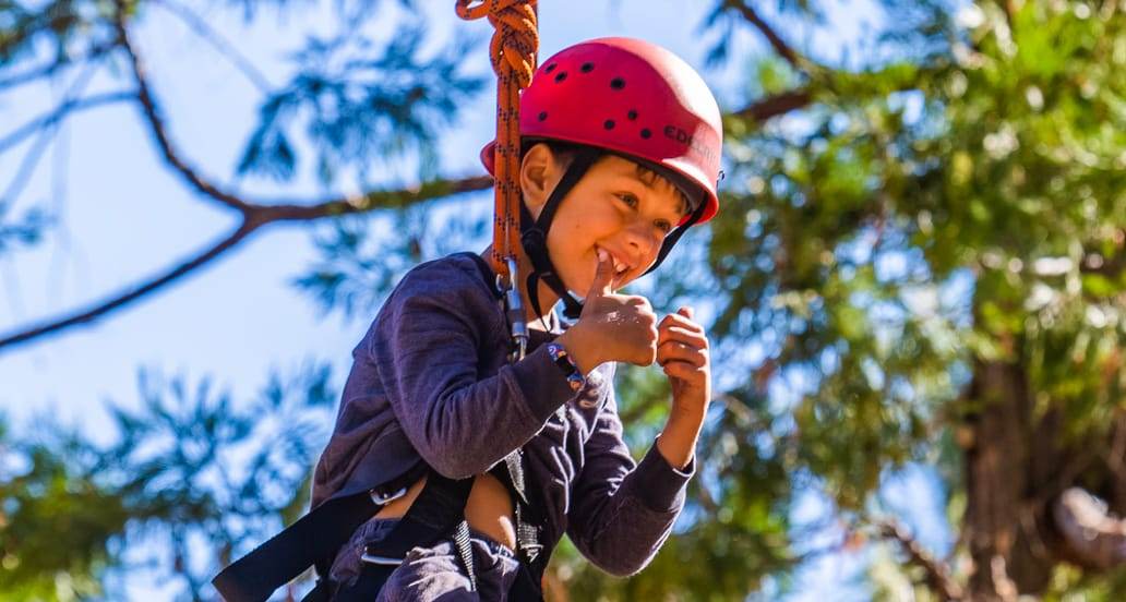 Boy on challenge course