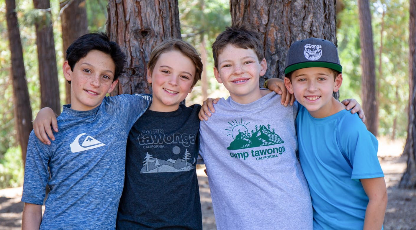 Four boys smiling