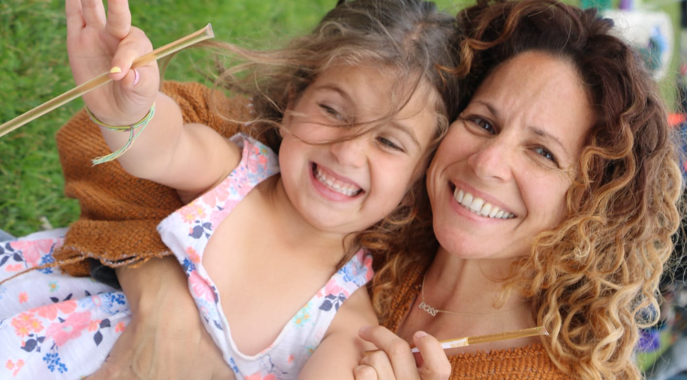 Mother and daughter with honey sticks at Rosh Hashanah