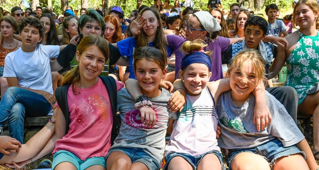 Four girls celebrating Judaism at camp
