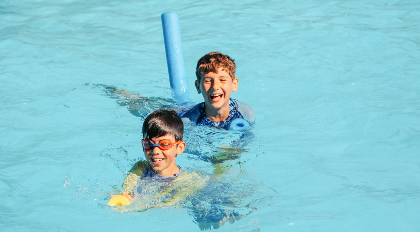 Two boys swimming in the pool