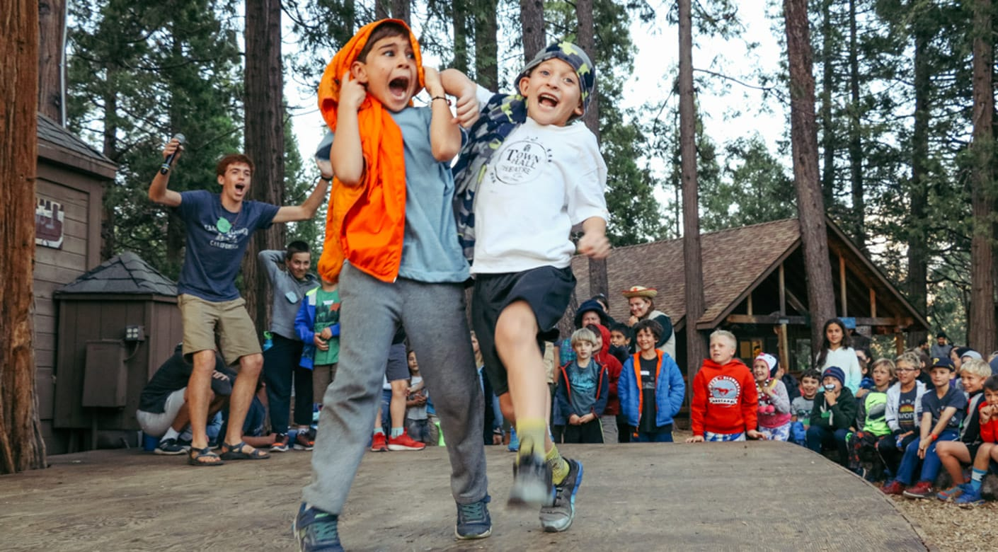 Two boys dancing at Taste of Camp