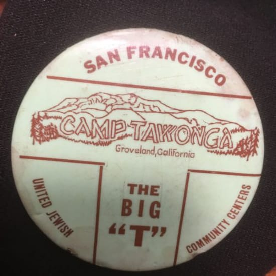 """Tawonga button with """"The Big 'T'"""" written on it"""