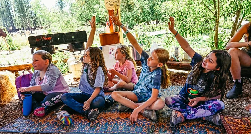Campers raising their hands in teva