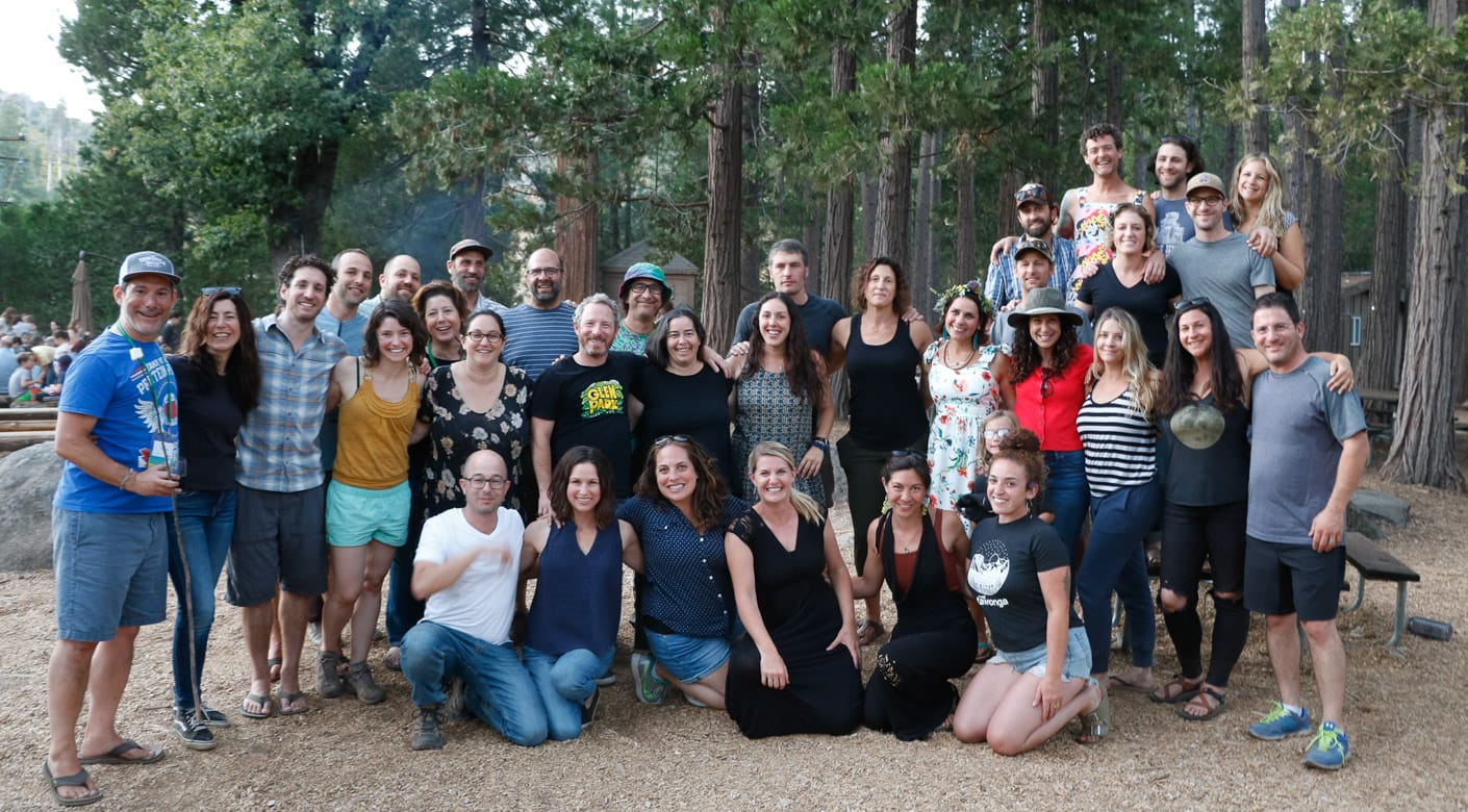 Group of alumni smiling at Camp Tawonga