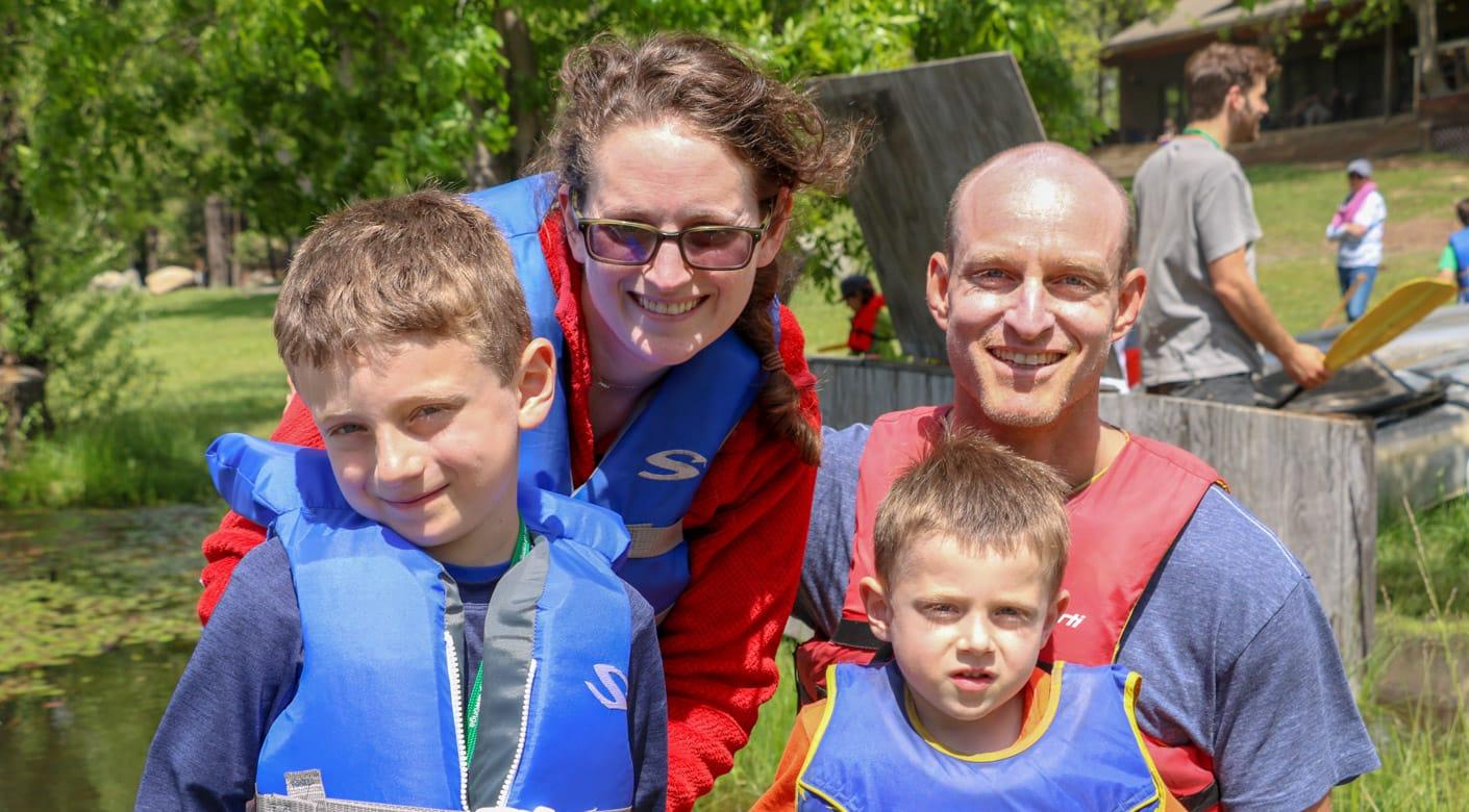 Family wearing life jackets at Family Camp