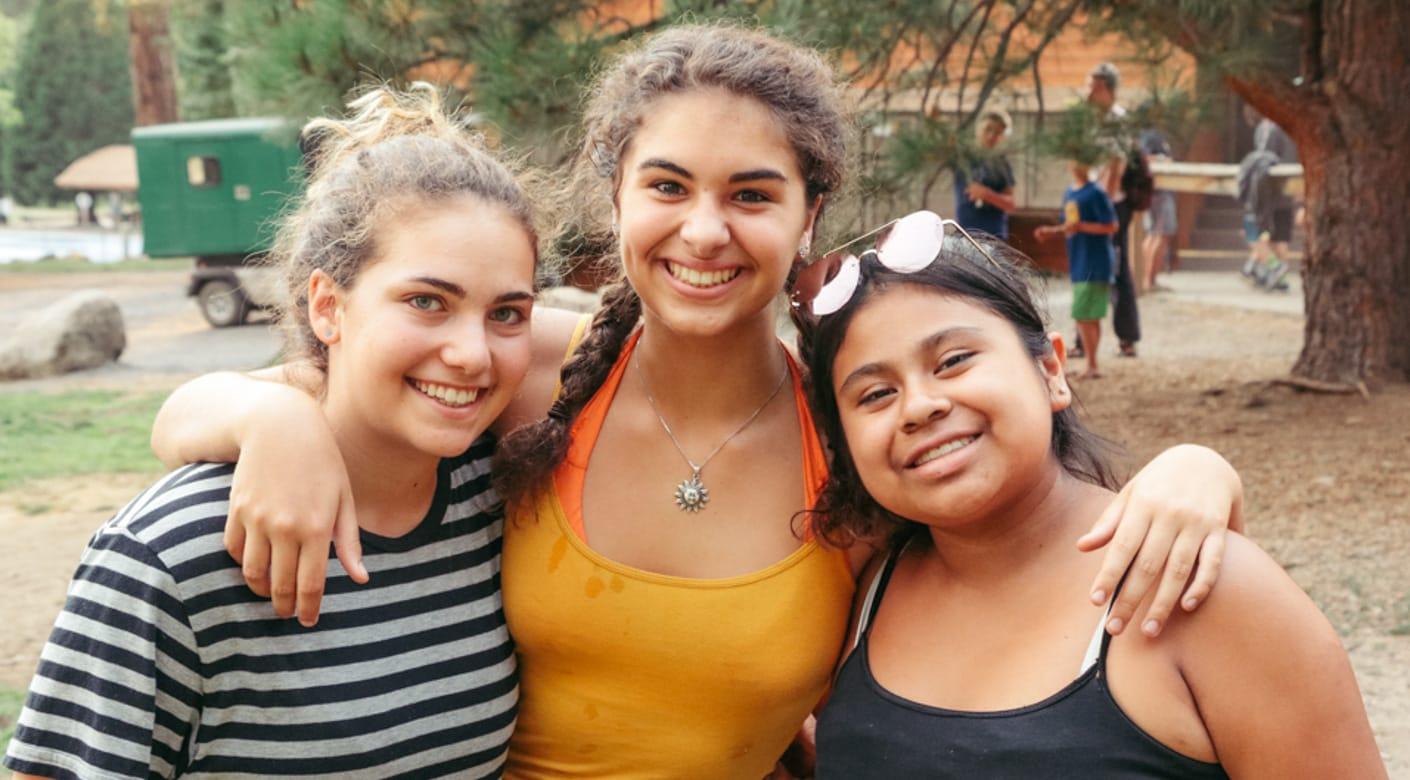 Three teens smiling at Teen Leadership program