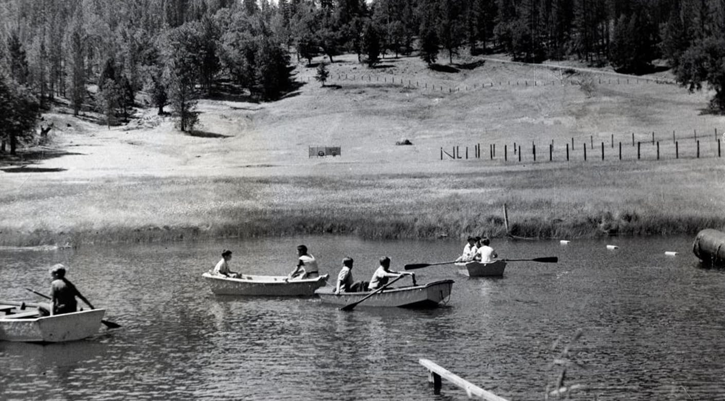70s photo of campers kayaking
