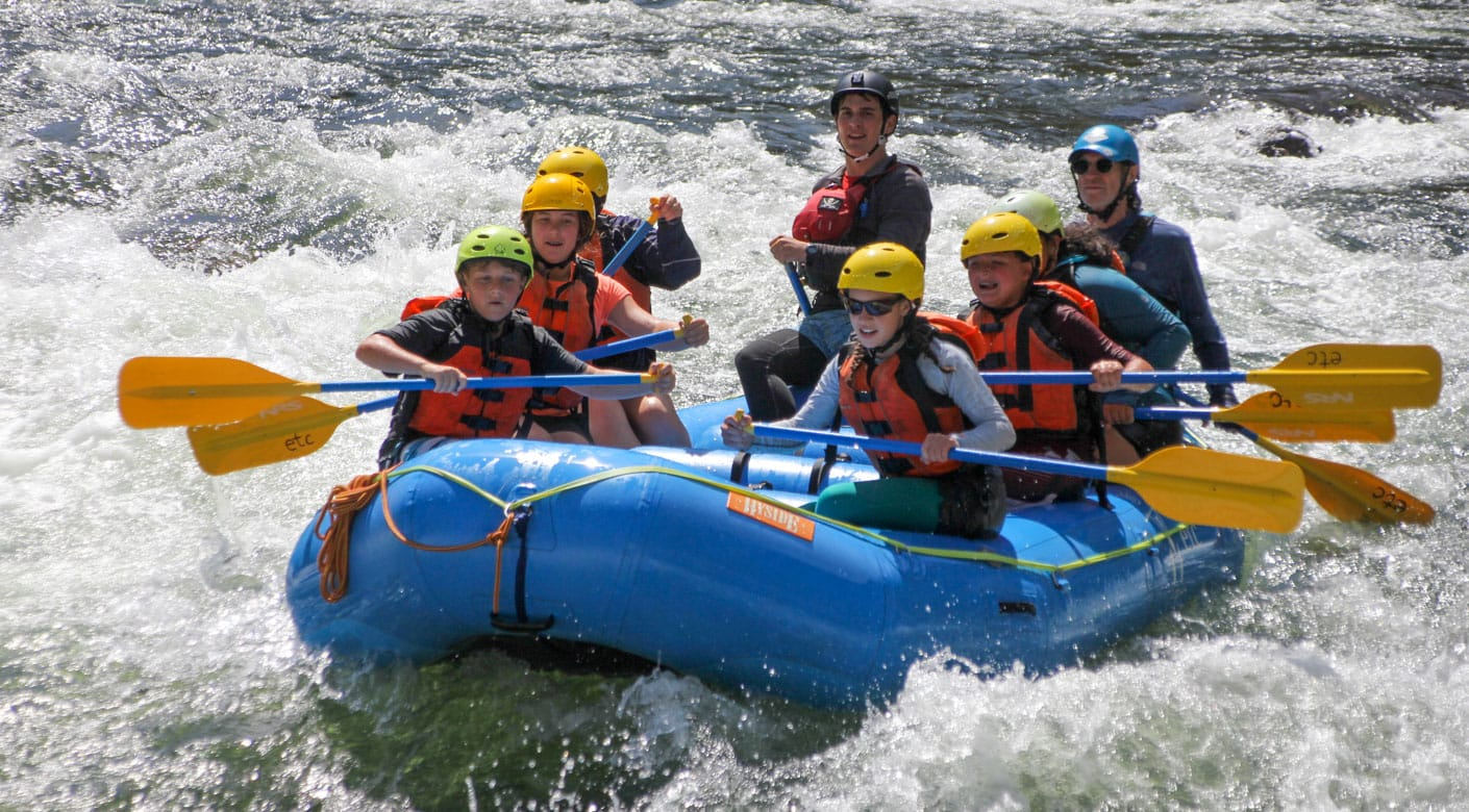 Teens rafting on an adventure quest