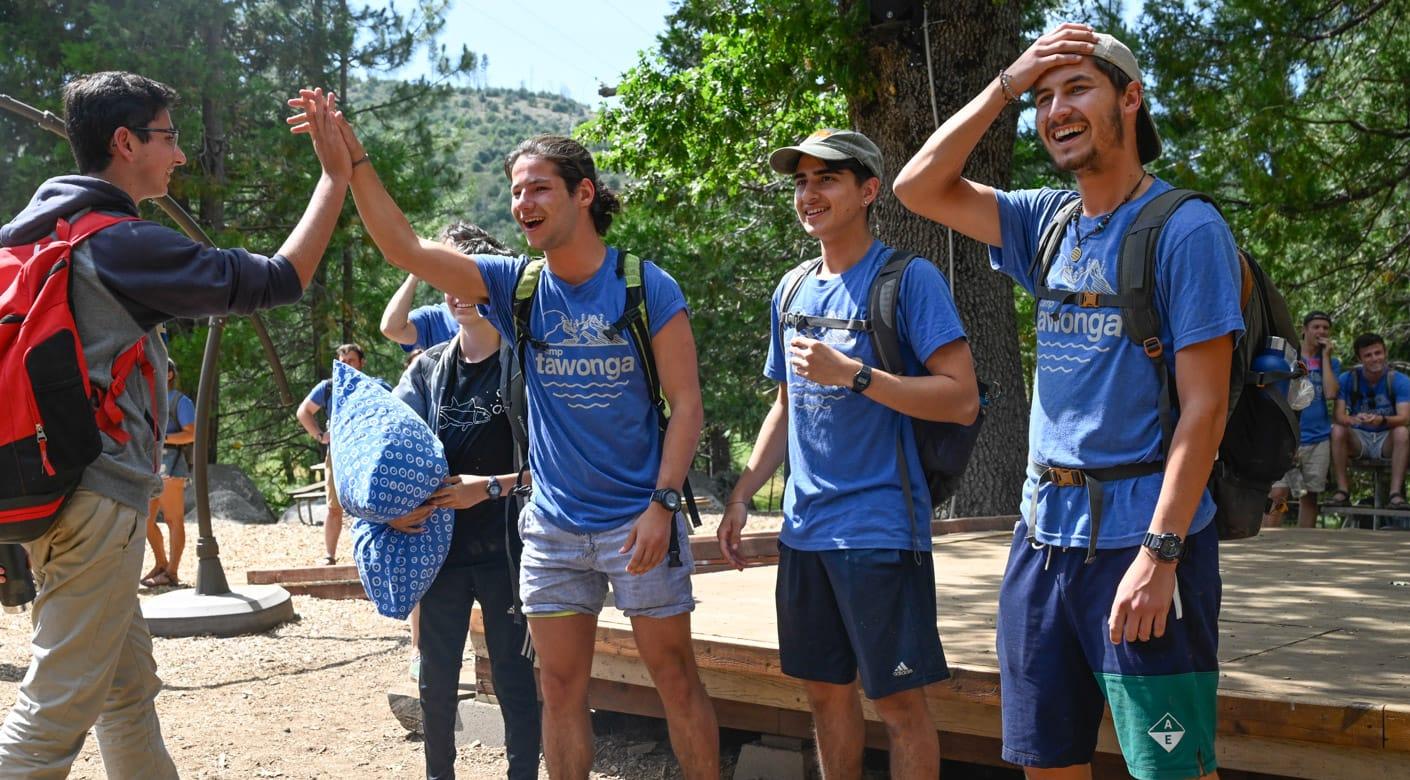 Staff giving a camper a high five