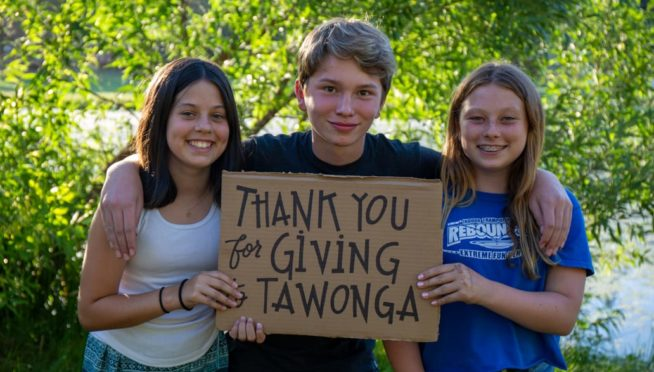 Three campers holding a thank you sign
