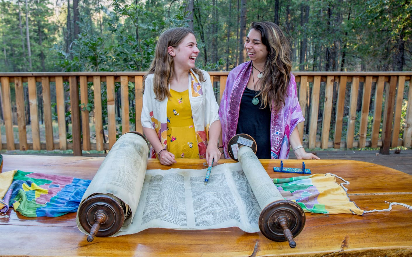 Girl and staff reading the Torah at a bat mitzvah