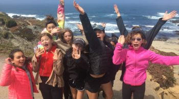 Teens by the coast on the Women of the Wild quest